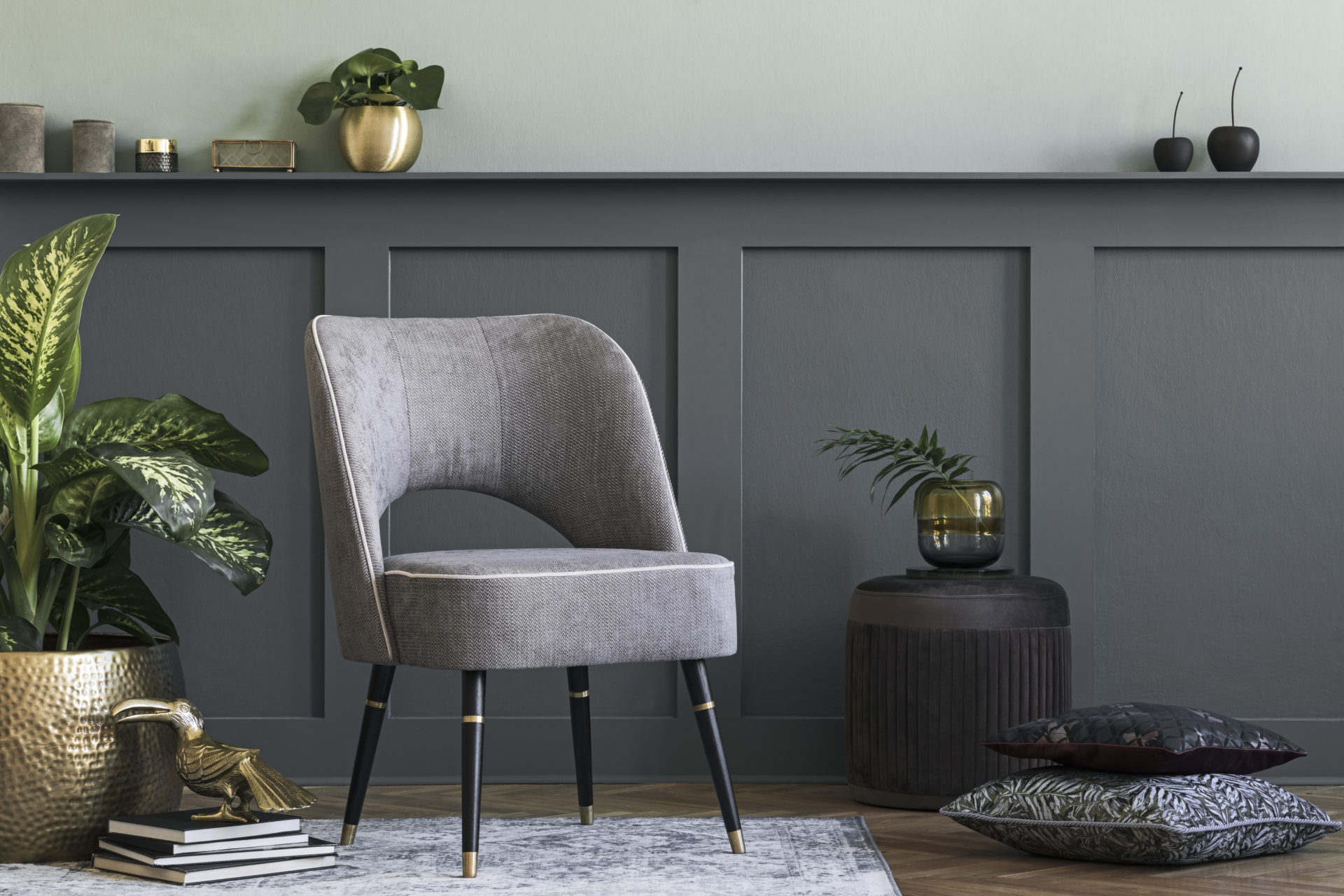 Modern Composition Of Living Room With Design Gray Armchair, Furniture, Gold Pot With Beautiful Plant And Elegant Personal Accessories. Gray Wall Panelling With Shelf. Stylish Home Staging. Template.
