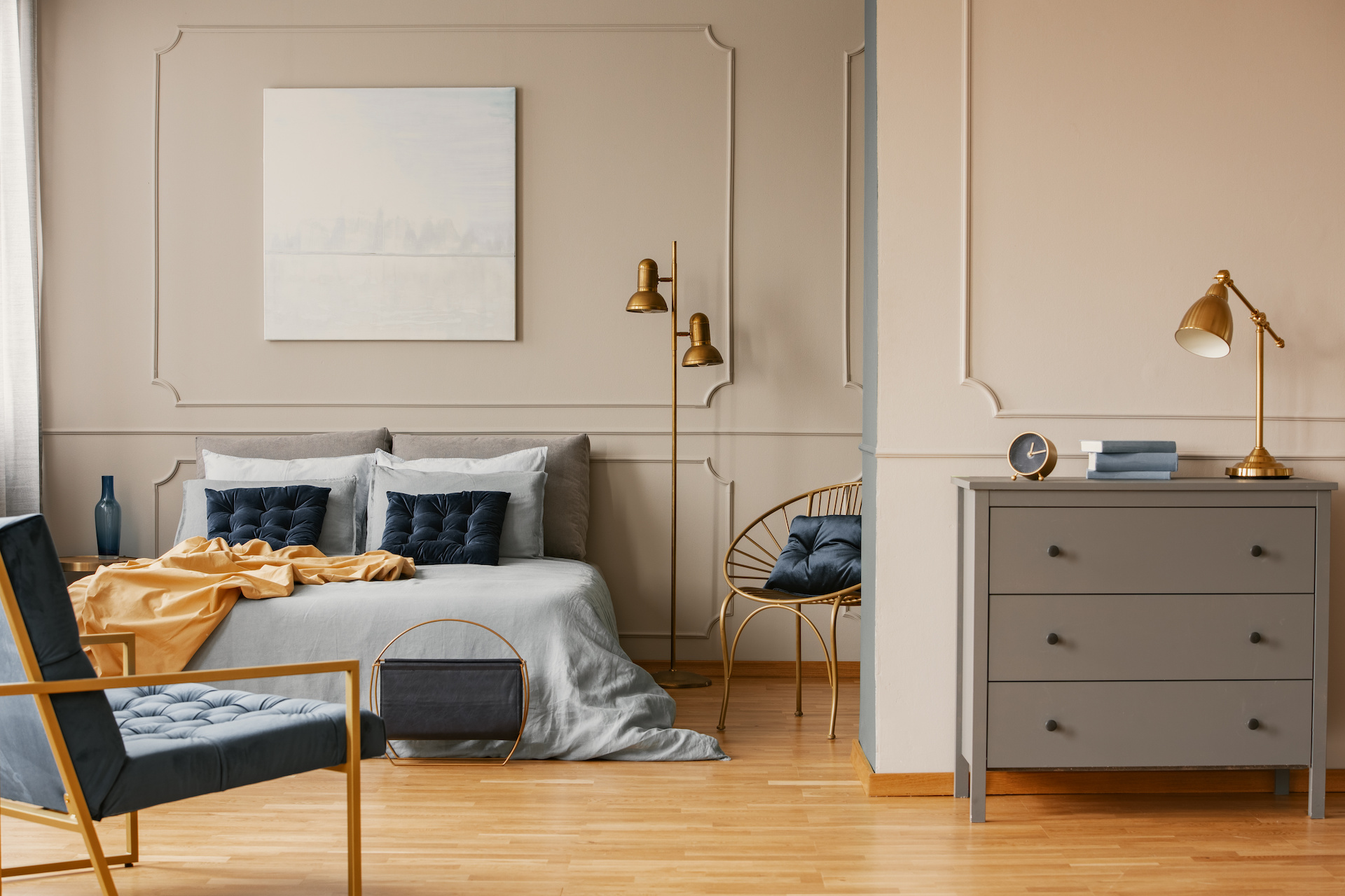 Elegant Bedroom Interior With King Size Bed, Painting On The Wall And Grey Commode
