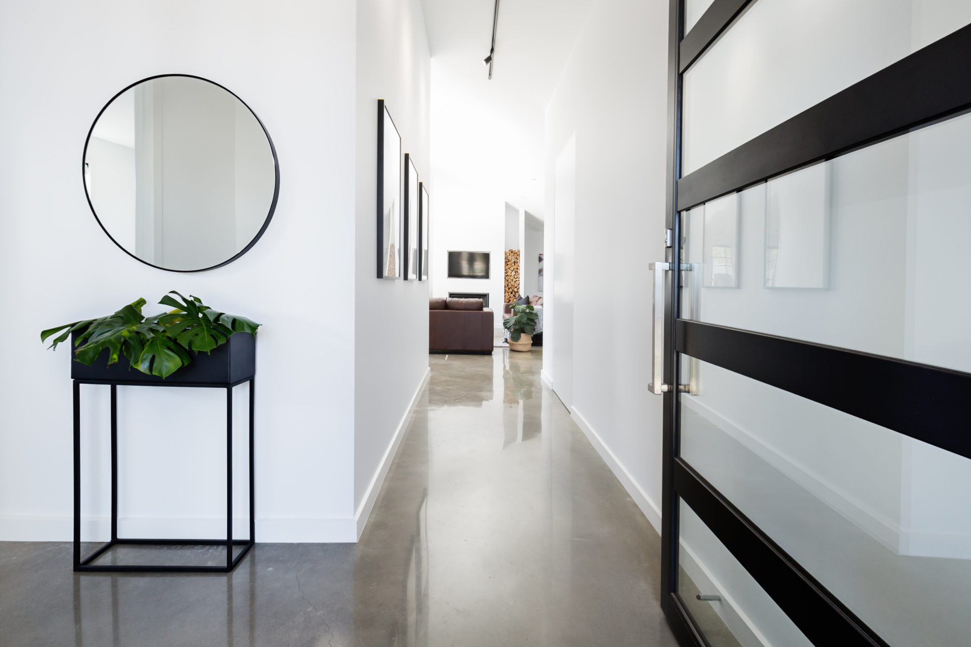 Contemporary Home Entry With Polished Concrete Floors